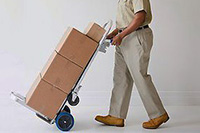 619-03660776 © Masterfile Royalty-Free Model Release: Yes Property Release: No African American deliveryman pushing hand truck with boxes